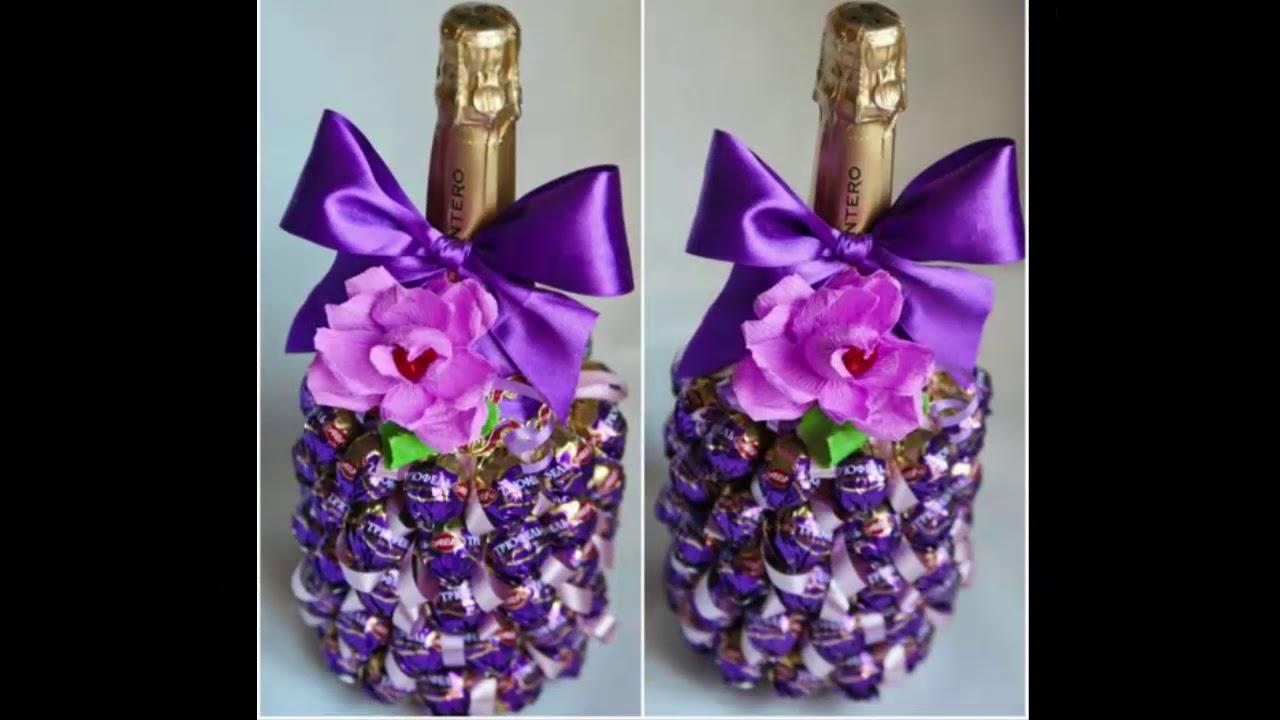 Украшение бутылки шампанского конфетами
